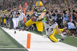 Jordy Nelson dives to the 3-yard line as he's defended by Steelers Troy Polamalu in the third quarter of Super bowl XLV.