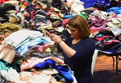 Tanya Mallory, director of programs and operations of Dress For Success Pittsburgh,  sorts clothes at the William Pitt Union in Oakland on March 3, 2015.
