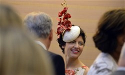 Milliner Gina Mazzotta wears one of her designs to a luncheon. Shop her creations at 5983 Broad Street in East Liberty.