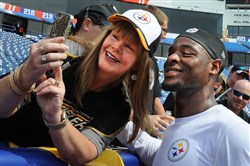 Steelers Le'Veon Bell takes a selfie with a lucky Steeler fan during pre-game at Ralph Wilson Stadium Orchard Park New York in August of last year.
