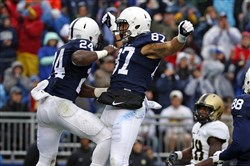 Penn State running back Nick Scott, left, celebrates with teammate Kyle Carter after scoring a touchdown during the first half of an NCAA college football game against Army in 2015.