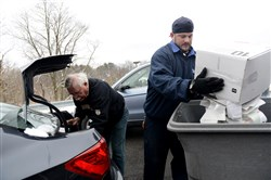 A Shred-A-Thon is scheduled for 10 a.m. to 1 p.m. on Saturday, August 24, 2019, at the AAA office in Pleasant Hills. In this file photo, David Wasiloski from Sewickley pulls boxes of paper from the trunk while Phil Calhoun with Shred-It out of North Versailles dumps paper to be shredded into a bin during a free Shred-A-Thon hosted by AAA East Central in Wexford Friday, March 4, 2016. The event held to shred personal sensitive documents was held to reduce help reduce identity theft.