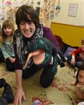 Megan Rooney flies the Spanish-speaking lizard who asks each child's age.