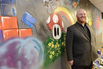 Ryan Askey of South Pittsburgh Development Corp. likes the vibe at places like Looking for Group, a co-working and gaming space in Brookline.