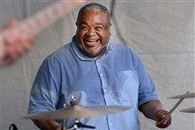 Drummer Poogie Bell performs under the tent Friday in Downtown's Katz Plaza with the Dwayne Dolphin Trio during the Pittsburgh JazzLive International Festival.
