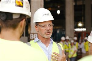 Limbach Holdings CEO Charles A. Bacon, pictured here at a job site, said the company has crafted a new strategy after severe labor shortages in Washington, D.C., contributed to a $4 million loss in 2018.