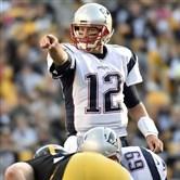 Patriots quarterback Tom Brady checks down the defense against the Steelers in the first quarter Sunday at Heinz Field.