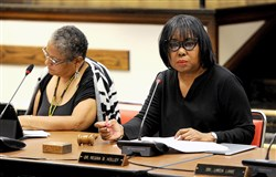 "In this June 15, 2016, file photo, Regina Holley, right, listens during a school board meeting in Oakland. After a school board vote Wednesday, Ms. Holley said the new contract for Pittsburgh teachers gives families ""peace of mind"" and district leadership ""clear parameters for our goals."""