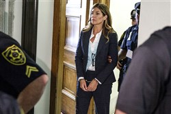 Former state Attorney General Kathleen Kane leaves court in handcuffs after her sentencing at the Montgomery County Courthouse in Norristown, Pa., on Monday, Oct. 24, 2016.