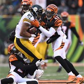 Ladarius Green leaves the game after suffering a concussion at the hands of Bengals safety George Iloka  at Paul Brown Stadium, Cincinnati Ohio.