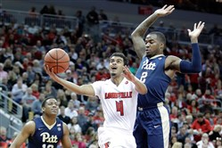Louisville's Quentin Snider shoots in front of Michael Young Wednesday night in Louisville, Ky.