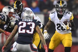 Le'Veon Bell picks up four yards against the Patriots during the AFC championship at Gillette Stadium.