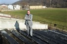 Christopher Whitlatch, chief executive the Mon Valley Alliance, stands in the old Charleroi High School football stadium. Mr. Whitlatch said the MVA plans to turn the stadium into a riverfront park.