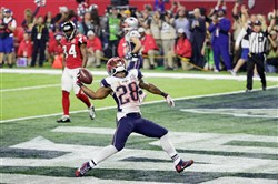 James White celebrates rushing for a 1-yard touchdown in the Super Bowl.