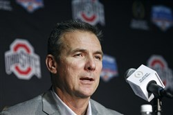 Ohio State placed football coach Urban Meyer on paid leave Wednesday.