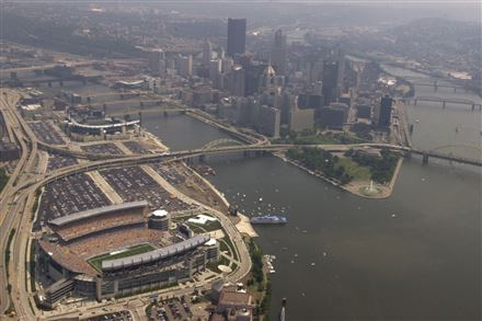A shot of the North Shore in 2001, with Heinz Field in the foreground and PNC Park behind. As development has filled in the pictured parking lots between the stadiums, the supply of North Shore parking spaces has dwindled.