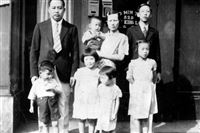 The Yee family: Back row, father Yee Toy, his wife Gee Shee Ho holding son Donald, and Yuen. In front are Robert, Ruth, Harriet and Anna.