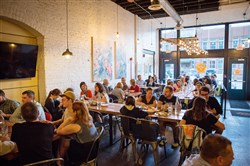 Restaurant patrons sit in the dining area at Smallman Galley in the Strip District.