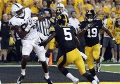 Penn State wide receiver Juwan Johnson, left, catches a touchdown pass as Iowa defensive backs Manny Rugamba (5) and Miles Taylor, right, watch as time expires during the second half of the Sept. 23, 2017 game in Iowa City.