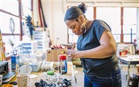 In this November 2017 file photo, Knotzland owner and designer Nisha Blackwell works at her studio in Homewood South.