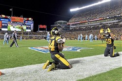 JuJu Smith-Schuster bows down to Antonio Brown after he pulled in a touchdown Nov. 16 against the Titans at Heinz Field.