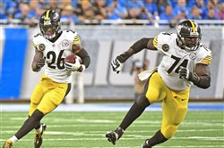 Chris Hubbard leads the way for Le'Veon Bell against the Lions on Oct. 29 at Ford Field.