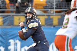 Pitt quarterback Kenny Pickett scrambles against Miami last November at Heinz Field.