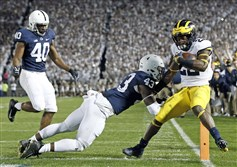 In this 2017 file photo, Penn State linebacker Manny Bowen, 43, misses a tackle against Michigan earlier this season.