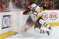 Penguins' Ian Cole falls to the ice in a game against the Philadelphia Flyers at Wells Fargo Center on January 2, 2018.