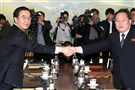 South Korea Unification Minister Cho Myung-Gyun (L) shakes hands with North Korean chief delegate Ri Son-Gwon (R) during their meeting at the border truce village of Panmunjom in the Demilitarized Zone dividing the two Koreas on January 9, 2018.