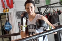 Mary Casamassa, shown in a mirror, is a unique two-sport standout at Aquinas Academy — excelling in basketball and in the boxing ring.