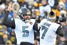 Jaguars quarterback Blake Bortles celebrates with Chad Henne after a touchdown against the Steelers in the fourth quarter last Sunday.