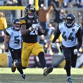 Steelers' Le'Veon Bell picks up a first down in a playoff game against the Jaguars on Jan. 14 at Heinz Field.