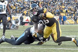 Steelers Le'Veon Bell scores a touchdown against the Jaguars in the Jan. 14 playoff loss   at Heinz Field.