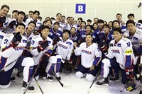 South Korean President Moon Jae-in, center top, poses with South Korean women's and men's ice hockey team players during a visit to Jincheon National Training Center in Jincheon, South Korea, on Jan. 17, 2018.