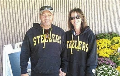 Jamie Creamer, left, is a Steelers fan in Patriots country.