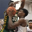Duquesne freshman Eric Williams Jr. battles George Mason's Greg Calixte during their game Saturday, January 20, 2018, in Pittsburgh.