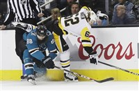 Penguins left wing Carl Hagelin skates over San Jose Sharks defenseman Brent Burns during the first period in San Jose, Calif., Saturday, Jan. 20, 2018.