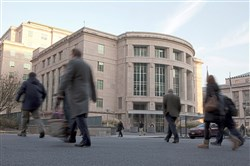 People walk by the Pennsylvania Judicial Center at the state Capitol in Harrisburg, Pa.
