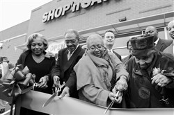 Long-time Hill District residents Pat and Clyde Hefflin, Carolyn Gray, and her mother, 105-year-old Lillian Allen, cut the ribbon to open the Hill District Shop 'n Save in 2013.