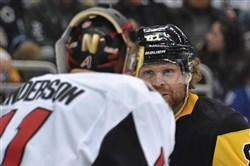 A feisty Phil Kessel exchanges words with Senators goalie Craig Anderson in a Feb. 13 game at PPG Paints Arena this past season.