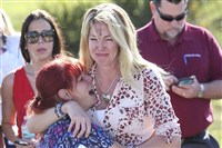 Parents wait for news after reports of the shooting in Parkland, Fla.