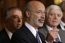 In this Oct. 7, 2015, file photo, Pennsylvania Gov. Tom Wolf, center, accompanied by state House Minority Leader Rep. Frank Dermody, right, D-Allegheny, and state Rep. Joe Markosek, left, D-Allegheny, discuss state budget negotiations at the state Capitol in Harrisburg, Pa.