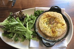 The Gerber Farms Chicken Pot Pie at the Union Standard comes with a side salad.