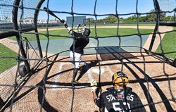 Pirates first baseman Josh Bell takes live batting practice during the first full-squad workout Monday at Pirate City in Bradenton, Fla.
