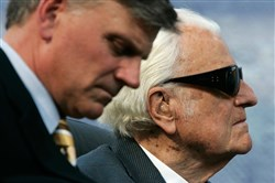 This file photo shows the evangelist Billy Graham (R) and his son Franklin (L) taking part in the Metro Maryland 2006 Festival on July 9, 2006, at Oriole Park at Camden Yards in Baltimore.