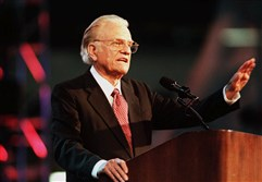 "In this June 3, 1999 file photo, the Rev. Billy Graham begins his message ""Just as I Am"" to a full house at the RCA Dome in Indianapolis to open his four-day crusade."