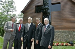 In this May 31, 2007 file photo, former Presidents, George H.W. Bush, left, Bill Clinton, second left, and Jimmy Carter, right, join Franklin Graham, second right, as they pose with Billy Graham, center, in front of the Billy Graham Library in Charlotte, N.C. Graham, who transformed American religious life through his preaching and activism, becoming a counselor to presidents and the most widely heard Christian evangelist in history, died at age 99.