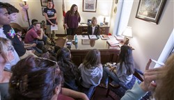 Florida Sen. Debbie Mayfield, center, listens as student survivors from Marjory Stoneman Douglas High School tell their personal experiences in her office at the Florida Capitol in Tallahassee, Fla., on Wednesday.