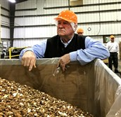 This file photo shows Agriculture Secretary Sonny Perdue at the Harris-Woolf Almonds processing plant in Coalinga, Calif., during a tour on Feb. 14, 2018.